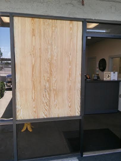 storefront board up after emergency