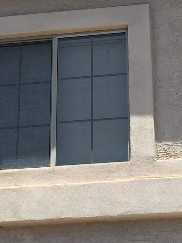 cracked dual pane window with grids